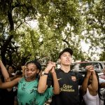 PRETORIA, SOUTH AFRICA – FEBRUARY 23: Tuks students pray for unity and peace on campus on February 23, 2016 at the Pretoria University in Pretoria, South Africa. Students  from all races formed a human chain to pray for peace and unity at the institution following  on-going race related student clashes over the language policy at the university. (Photo by Gallo Images / Beeld / Nelius Rademan)